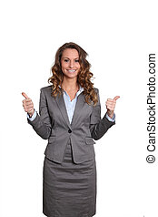 Businesswoman standing on white background with thumbs up