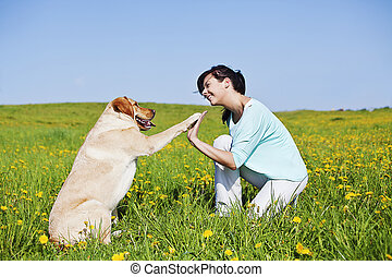 high five - happy girl and her dog doing high five