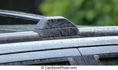 Rainy roofrack. - Car roofrack with rain falling. Shallow...