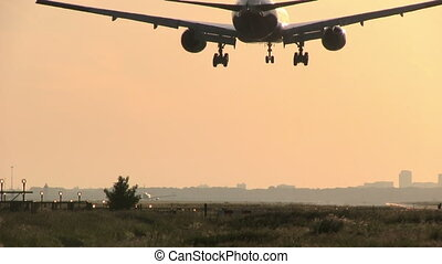 Big plane sunset landing