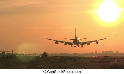 Big plane landing at sunrise