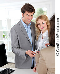 Couple in garment store buying clothes