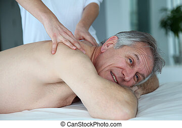 Senior man having a massage