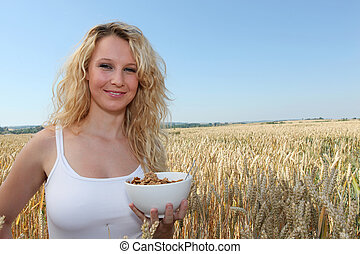 beautiful blonde woman with bowl of cereals