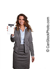 Businesswoman standing on white background with calculator