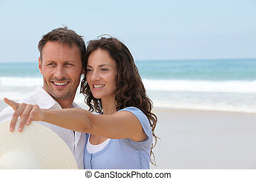 Smiling couple on vacation at the beach