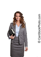 Businesswoman standing on white background with agenda