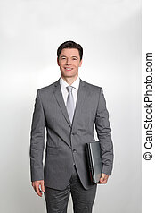 Businessman standing on white background with laptop computer