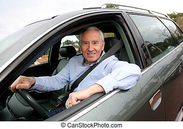 Elderly man driving car