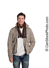 Adult man with winter clothes standing on white background
