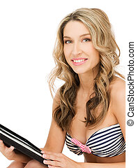 woman in bikini with tablet pc computer - picture of happy...