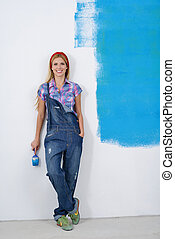 happy smiling woman painting interior of house - happy...