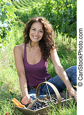 Winegrower woman in vineyard