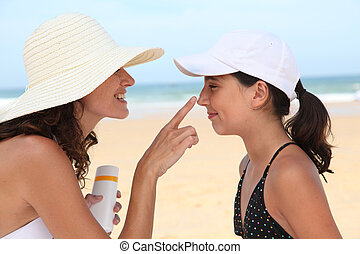 Mother and daugther at the beach