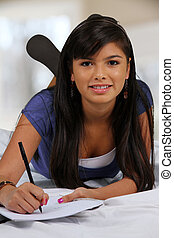 Teenager On Her Bed - Teenage girl laying in her bed with...