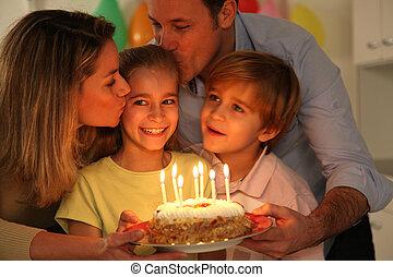 Family celebrating childs birthday