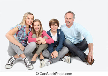Happy smily family sitting on white background