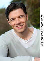 Portrait of handsome smiling man