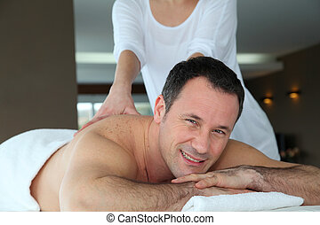 Handsome man having a massage