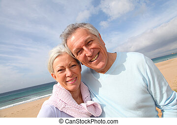 Happy senior couple at the beach
