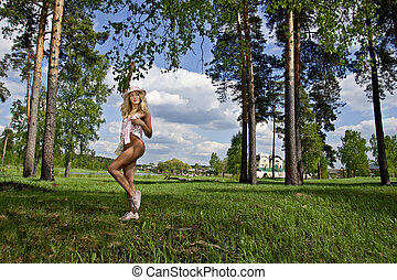 Beautiful young woman on a park
