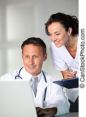Doctor and nurse working in the office