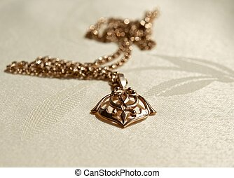Gold pendant on a chain