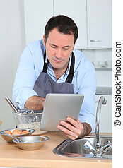 Man looking at recipe on internet