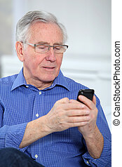 Elderly man talking on mobile phone
