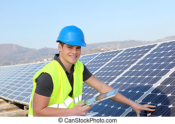 Young adult doing professional training on solar panels...
