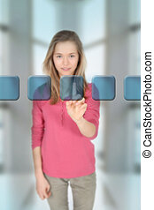 Teenage girl touching virtual screen