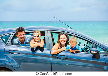 Family of four driving in a car