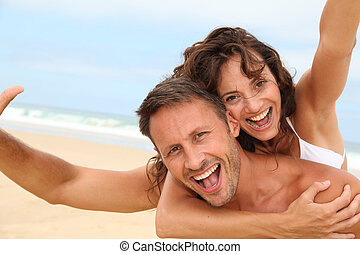 Couple having fun at the beach