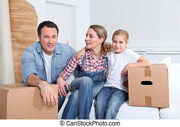 Happy family moving in new house