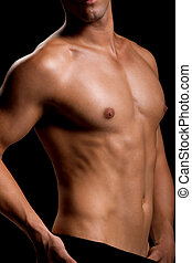 Healthy muscular young man Isolated on black background...