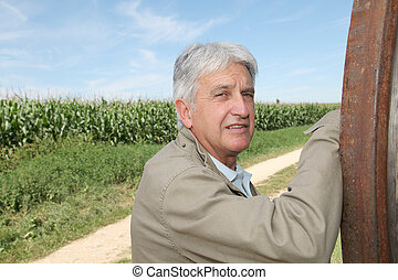 Closeup of agronomist in front of corn field