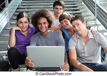 Group of college students with laptop computer