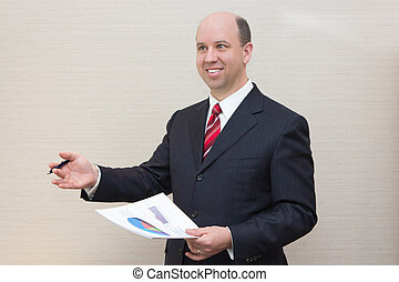 Smiling business man with document.