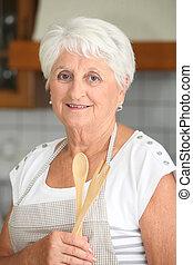 Elderly woman in home kitchen