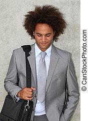 Portrait of a businessman in grey suit