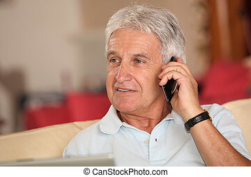 Closeup of senior man talking on mobile phone