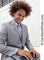 Young businessman working oustide the office