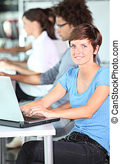 Young woman working on laptop computer