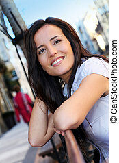 Portrait of beautiful smiling woman in town