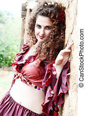 beautiful gypsy girl in red dress - Gypsy is looking forward...
