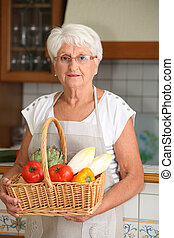 Elderly woman in kitchen