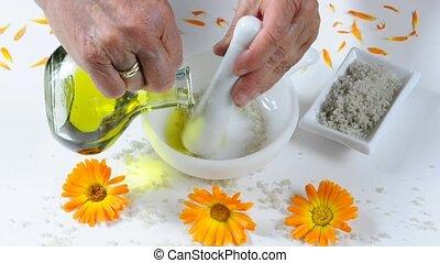 skin peeling - preparing a skin peeling with sea salt and...