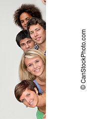 Group of young people with message board