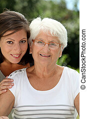 Closeup of elderly woman with grandaughter