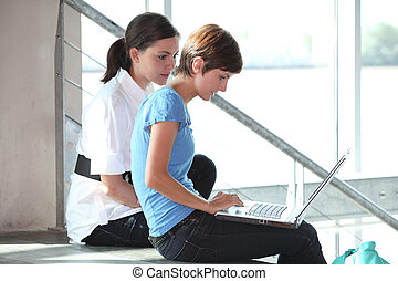 Young women working on laptop computer